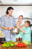 Cooking veggy lunch in kitchen Royalty Free Stock Photos