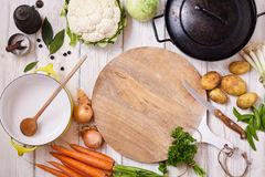 Cooking Wares and Fresh Vegetables on Table Stock Images