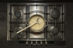 Cooking white rice in water with chicken stock Stock Images