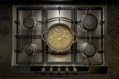 Cooking white rice in water with chicken stock Royalty Free Stock Photography