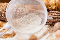 Cooking. White sieve with flour and bread Stock Photography