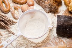 Cooking. White sieve with flour and bread Royalty Free Stock Photo