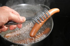 Cooking wiener. Wiener in the pot Stock Photos