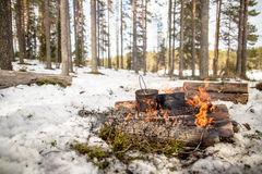 Cooking in a winter hike in the cauldron hanging over the fire Stock Photography