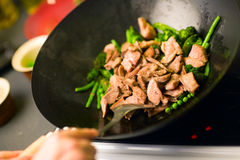 Cooking Wok. Chef cooking vegetables and meat in wok pan Stock Images