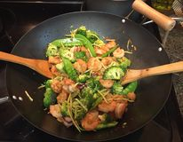 Cooking. Wok cooking seafood Royalty Free Stock Photos