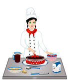 Cooking woman chef. Happy pastry chef preparing cake with strawberries Royalty Free Stock Photos