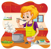 Cooking. Woman cooking food in the kitchen Royalty Free Stock Photo
