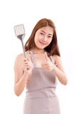 Cooking woman giving thumb up to you, white isolated Royalty Free Stock Photography