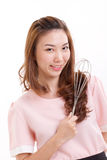 Cooking woman or housewife, holding whisker Royalty Free Stock Photo