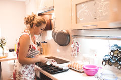 Cooking woman in kitchen Stock Photography