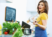 Cooking woman in kitchen with wooden spoon. Organic breakfast prepare Stock Photo