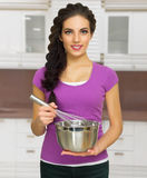 Cooking woman in the kitchen Royalty Free Stock Images