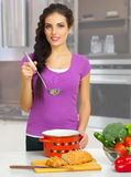 Cooking woman in the kitchen Royalty Free Stock Image