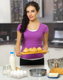 Cooking woman at kitchen Royalty Free Stock Image