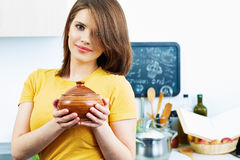Cooking woman standing in kitchen with pot. Stock Photo