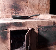 Cooking at wood burning oven royalty free stock image