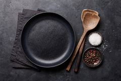 Cooking wooden utensils and empty plate royalty free stock image