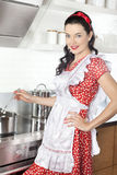 Cooking young woman Royalty Free Stock Photos