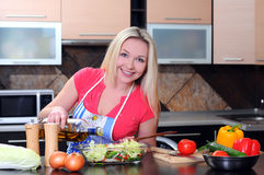 Cooking. Young Woman Cooking. Healthy Food - Vegetable Salad. Diet. Dieting Concept. Healthy Lifestyle. Cooking At Home. Prepare Food stock image