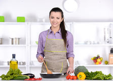 Cooking. Young Woman Cooking. Healthy Food - Vegetable Salad. Diet. Dieting Concept. Healthy Lifestyle. Cooking At Home. Prepare Food stock photos