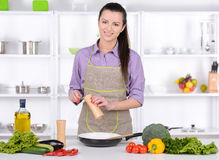 Cooking. Young Woman Cooking. Healthy Food - Vegetable Salad. Diet. Dieting Concept. Healthy Lifestyle. Cooking At Home. Prepare Food royalty free stock image