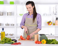 Cooking. Young Woman Cooking. Healthy Food - Vegetable Salad. Diet. Dieting Concept. Healthy Lifestyle. Cooking At Home. Prepare Food royalty free stock images