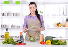 Cooking. Young Woman Cooking. Healthy Food - Vegetable Salad. Diet. Dieting Concept. Healthy Lifestyle. Cooking At Home. Prepare Food stock photo