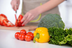 Cooking. Young Woman Cooking. Healthy Food - Vegetable Salad. Diet. Dieting Concept. Healthy Lifestyle. Cooking At Home. Prepare Food stock photography