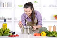 Cooking. Young Woman Cooking. Healthy Food - Vegetable Salad. Diet. Dieting Concept. Healthy Lifestyle. Cooking At Home. Prepare Food royalty free stock photography