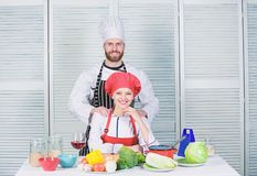 Cooking with your spouse can strengthen relationships. Woman and bearded man culinary partners. Ultimate cooking. Cooking with your spouse can strengthen stock photography