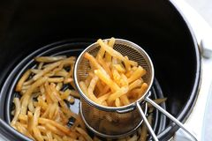 Cooking yummy french fries Stock Image