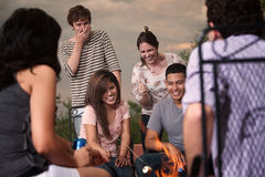 Cookout Party. Group of six friends roasting marshmallows in a cookout party Royalty Free Stock Photography