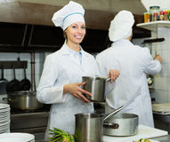 Cooks cooking at professional kitchen. Head-cooks cooking at professional kitchen in the restaurant royalty free stock photography