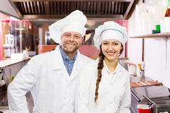 Cooks cooking at professional kitchen Royalty Free Stock Photo