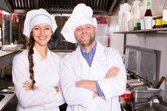 Cooks cooking at professional kitchen Royalty Free Stock Photography