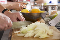 Cooks are cutting onions Royalty Free Stock Images