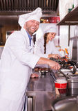 Cooks greeting customers at bistro Stock Image