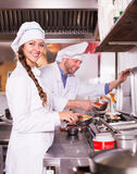Cooks greeting customers at bistro Royalty Free Stock Photography