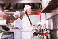 Cooks greeting customers at bistro Royalty Free Stock Images
