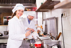 Cooks greeting customers at bistro Stock Photos