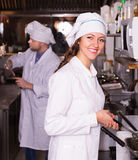 Cooks greeting customers at bistro Stock Photo