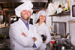 Cooks greeting customers at bistro Royalty Free Stock Image