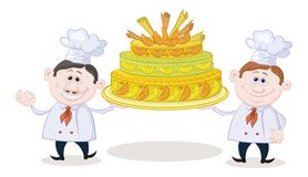 Cooks with holiday cake Royalty Free Stock Image