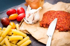 Cooks` ingredients for pasta with spicy nduja sausage with tomat Royalty Free Stock Photo