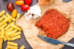 Cooks` ingredients for pasta with spicy nduja sausage with tomat Stock Photography