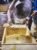 Cooks making dough for Tortillas on a kneading trough royalty free stock image