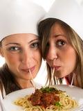 Cooks with pasta Stock Photo