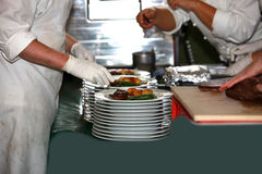 Cooks in the preparation and decoration of food. In kitchen Royalty Free Stock Images