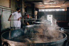 Cooks preparing food portion for pilgrims. The Kitchen at Golden Temple royalty free stock photo
